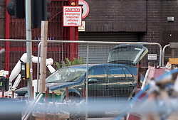 © Licensed to London News Pictures. 14/08/2016. Bristol, UK. A bomb disposal robot arm can be seen going through a broken side window inside the front passenger area of a car. Police seal off parts of Bristol city centre and call in the Bomb Disposal team after a suspicious vehicle, thought to be a green VW car was found parked right by Bridewell Police station. Photo credit : Simon Chapman/LNP