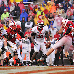 Sep 26, 2009; College Park, MD, USA; Rutgers cornerback Joe Lefeged (26) strips the ball from Maryland quarterback Chris Turner (10) in Maryland's end zone during the second half of Rutgers' 34-13 victory over Maryland in NCAA college football at Byrd Stadium.