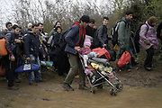 March 14, 2016 - Idomeni, Greece - <br /> <br /> The deadly new route into Europe: Thousands of migrants, including children and a man in a wheelchair, wade across a treacherous river to get to Macedonia<br /> <br /> Greece/Macedonia border Idomeni/Gevgelija  march 14,  2016. Thousands of migrants stranded in the camp of Idomeni decide to cross the Macedonian border at the end of the wire fence , walking for hours and crossing the river with very cold water helped by volunteers . Dozens of journalists and volunteers arrested by Macedonian police in the afternoon for illegal entry. <br /> ©Exclusivepix Media