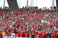 Wales fans celebrate their win at the end of the match. Euro 2016, Wales v Slovakia at Matmut Atlantique , Nouveau Stade de Bordeaux  in Bordeaux, France on Saturday 11th June 2016, pic by  Andrew Orchard, Andrew Orchard sports photography.