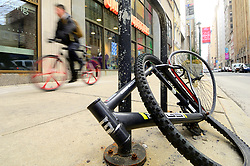 Frame and parts of the wheels remain locked on the street while the rest of what was once a bicycle were taken, in center City Philadelphia, PA, on March 11, 2019.