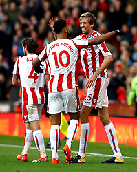 Stoke City's Peter Crouch (right) celebrates scoring his side's second goal of the game