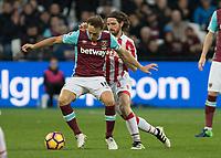 Football - 2016 / 2017 Premier League - West Ham United vs. Stoke City<br /> <br /> Mark Noble of West Ham holds off Joe Allen of Stoke City at The London Stadium.<br /> <br /> COLORSPORT/DANIEL BEARHAM