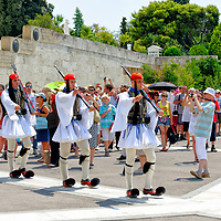 Syntagma square. Athens. Greece. View of Greek Evzones arriving to perform the very slow and highly stylized ceremonial changing of the guard at the monument to the Unknown Soldier in Athens.