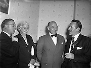 24/09/1958<br /> 09/24/1958<br /> 24 September 1958<br /> Opening of Le Pompadour Salon by the Lord Mayor of Dublin Catherine Byrne, for Mr. Victor Vinmar at 6 Upper Fitzwilliam Street, Dublin. Image shows people at the opening. Mr Vinmar is possibly the gentleman on the right.