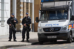 London, June 4th 2017. Armed police patrol near the scene during a massive policing operation in the aftermath of the terror attack on London Bridge and Borough Market on the night of June 3rd which left seven people dead and dozens injured.