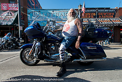 Malaquias Lujan of Colorado Springs on Sturgis' Main Street on the final Saturday of the annual Black Hills Motorcycle Rally.  SD, USA.  August 13, 2016.  Photography ©2016 Michael Lichter.