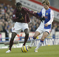 Photo: Aidan Ellis.<br /> Blackburn Rovers v Arsenal. The Barclays Premiership. 25/02/2006.<br /> Blackburn's Morten Gamst Pedersen challenges Arsenal's Emanuel Adebayor
