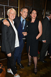Left to right, EMMA HINDLEY, HUGO MACGREGOR and LOUISE HOOPER at a dinner hosted by Lucy Yeomans and Amanada Foreman to celebrate the launch of the film Georgiana, Duchess of Devonshire held at sackville's, Sackville Street, London on 7th September 2015.