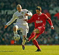 Photo. Jed Wee.<br /> Leeds United v Liverpool, FA Barclaycard Premiership, Elland Road, Liverpool. 29/02/2004.<br /> Liverpool's Harry Kewell (R) is well marshalled by Leeds' Seth Johnson on his return to Elland Road.