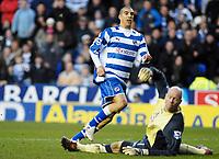 Photo: Gareth Davies.<br />Reading v Blackburn Rovers. The Barclays Premiership. 16/12/2006.<br />Reading's James Harper (L) slots the ball past the Blackburn Keeper to make it 1-0 to Reading.