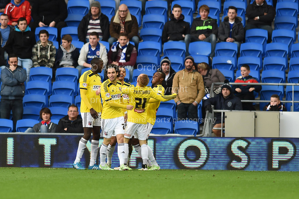 Alex Pritchard © of Brentford celebrates with his temmates after he scores his teams 1st goal. Skybet football league championship match, Cardiff city v Brentford at the Cardiff city stadium in Cardiff, South Wales on Saturday 20th December 2014<br /> pic by Andrew Orchard, Andrew Orchard sports photography.