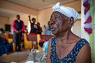 Italia Nelson sits during Sunday service at First Beraca Baptist Church in Marsh Harbour on Abaco Island on Sunday, September 8, 2019.