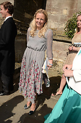 ASTRID HARBORD at the wedding of Lady Natasha Rufus Isaacs to Rupert Finch held at St.John The Baptist Church, Cirencester, Gloucestershire, UK on 8th June 2013.