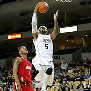 Central Florida guard Marcus Jordan (5) drives to the basket against Louisville during their game at the UCF Arena on December 15, 2010 in Orlando, Florida. UCF won the game79-58. (AP Photo/Alex Menendez)