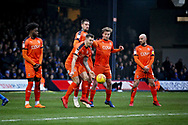 Luton Town FC forward James Collins (19) stands firm in the wall after this free kick  during the EFL Sky Bet League 1 match between Luton Town and Peterborough United at Kenilworth Road, Luton, England on 19 January 2019.