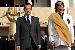 Libya's President Moammar Gadhafi and his counterpart from France Nicolas Sarkozy listen to national anthems at Bab Azizia Palace in Tripoli, Libya on July 25, 2007. France and Libya on Wednesday signed a memorandum of understanding to build a Libyan nuclear reactor for water desalination and clinched a raft of other deals. Photo by Christophe Guibbaud/ABACAPRESS.COM