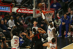 December 17, 2018 - Los Angeles, CA, U.S. - LOS ANGELES, CA - DECEMBER 17: Los Angeles Clippers Center Montrezl Harrell (5) just missing Portland Trail Blazers Guard CJ McCollum (3) shot during the Portland Trail Blazers at Los Angeles Clippers NBA game on December 17, 2018 at Staples Center in Los Angeles, CA.. (Photo by Jevone Moore/Icon Sportswire) (Credit Image: © Jevone Moore/Icon SMI via ZUMA Press)