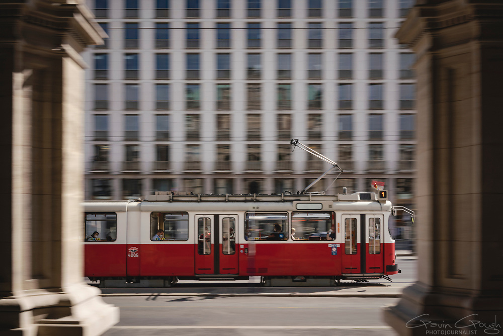 No. 1 tram seen through the pillars of the Opera House, Wiener Staatsoper (Vienna State Opera), Vienna, Austria
