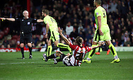 Brentford striker Lasse Vibe trying to claim a penalty during the Sky Bet Championship match between Brentford and Huddersfield Town at Griffin Park, London, England on 19 December 2015. Photo by Matthew Redman.