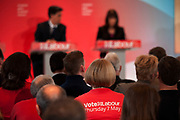 London, UK. Wednesday 29th April 2015. Labour Party supporter wearing a 'Vote Labour Thursday 7th May' t-shirt at a General Election 2015 campaign event on the Tory threat to family finances, entitled: The Tories' Secret Plan. Held at the Royal Institute of British Architects.
