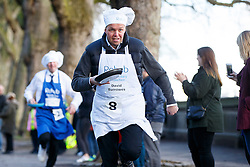 © Licensed to London News Pictures. 28/02/2017. London, UK. DAVID BURROWES MP races against Lords and members of media at the annual Rehab Parliamentary Pancake Race outside the Parliament on Shrove Tuesday, 28 February 2017. Photo credit: Tolga Akmen/LNP