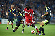 Kenwyne Jones of Cardiff city ©  holds off Middlesbrough's Kenneth Omeruo (l) .Skybet football league championship match, Cardiff city v Middlesbrough at the Cardiff city stadium in Cardiff, South Wales on Tuesday 16th Sept 2014<br /> pic by Andrew Orchard, Andrew Orchard sports photography.