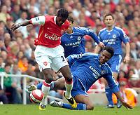 Photo: Ed Godden/Sportsbeat Images.<br /> Arsenal v Chelsea. The Barclays Premiership. 06/05/2007.<br /> Arsenal's Emmanuel Adebayor (L), is met by a tackle from John Obi Mikel.