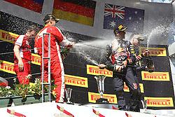 26.07.2015, Hungaroring, Budapest, HUN, FIA, Formel 1, Grand Prix von Ungarn, das Rennen, im Bild Sektdusche auf dem Podium<br /> Sebastian Vettel (Scuderia Ferrari)<br /> Daniel Ricciardo (Infiniti Red Bull Racing/Renault)<br /> Daniil Kwjat (Infiniti Red Bull Racing/Renault) // during the race of the Hungarian Formula One Grand Prix at the Hungaroring in Budapest, Hungary on 2015/07/26. EXPA Pictures © 2015, PhotoCredit: EXPA/ Eibner-Pressefoto/ Bermel<br /> <br /> *****ATTENTION - OUT of GER*****