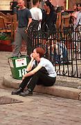 Thoughtful woman age 25 sitting on curb.   Poznan Poland