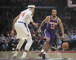 November 28, 2018 - Los Angeles, California, U.S - T.J. Warren #12 of the Phoenix Suns tries to get past Tobias Harris #34 of the Los Angeles Clippers during their NBA game on Wednesday November 28, 2018 at the Staples Center in Los Angeles, California. Clippers vs Suns. (Credit Image: © Prensa Internacional via ZUMA Wire)