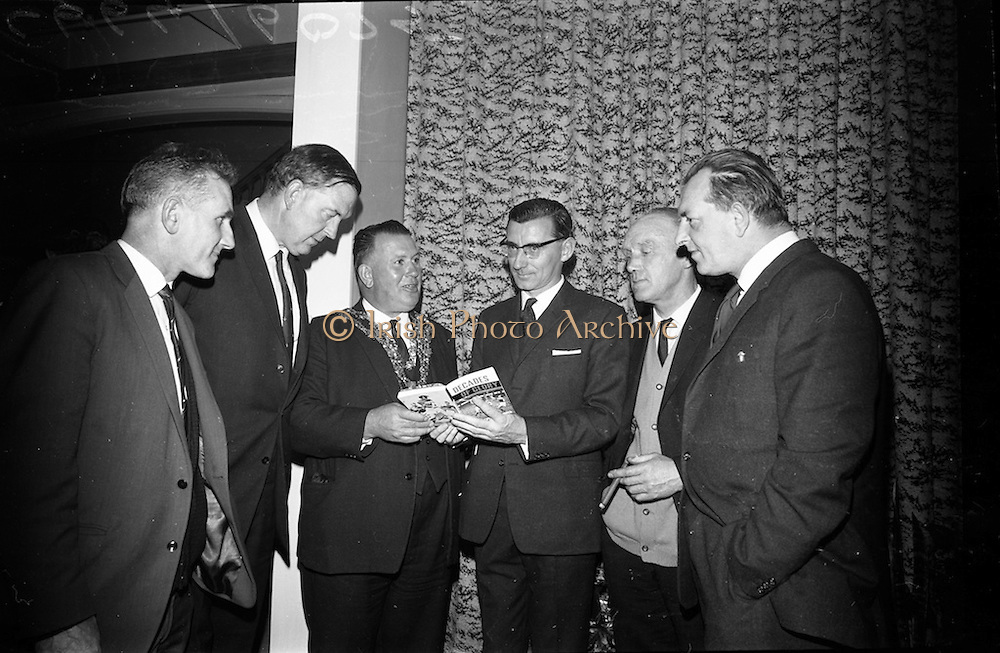 "17/05/1966<br /> 05/17/1966<br /> 17 May 1966<br /> Book reception for ""Decades of Glory: A Comprehensive History of the National Game"" by Raymond Smith.<br /> This reception was held in the offices of W.D. & H.O. Wills to honour the well known author and journalist, Raymond Smith. His book on the history of Hurling (""Decades of Glory"") has just been published with the assistance of Wills of Dublin and Cork and the Central Council of the G.A.A.<br /> Picture shows (from left to right): Phil Grimes (Waterford), Mr. D.R. Mott (Managing Director of Wills of Dublin and Cork), Patrick Browne (Mayor of Waterford), Raymond Smith (Author), John Keane (Waterford), and Larry Lyons (Editor, Waterford News 2 star) chatting at the reception."