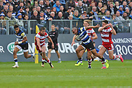 Bath centre Jonathan Joseph (13) passes the ball to the wings during the Aviva Premiership match between Bath Rugby and Gloucester Rugby at the Recreation Ground, Bath, United Kingdom on 29 October 2017. Photo by Gary Learmonth.