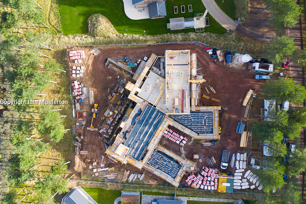 Aerial view of construction of large modern luxury house on waterfront at Archerfield Estate in East Lothian, Scotland ,UK