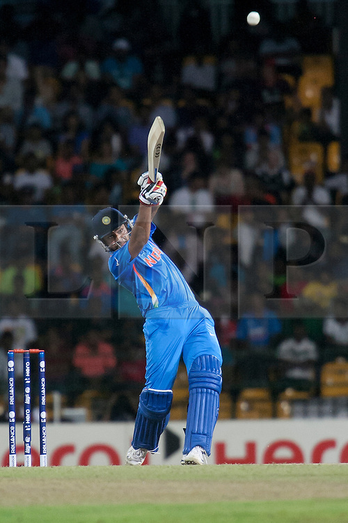 © Licensed to London News Pictures. 23/09/2012. Rohit Sharma of India batting during the T20 Cricket World T20 match between England Vs India at the R.Premadasa Cricket Stadium,Colombo. Photo credit : Asanka Brendon Ratnayake/LNP