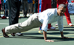 U.S. President Barack Obama does push-ups during a basketball clinic during the White House Easter Egg Roll on the South Lawn of the White House in Washington, D.C. on April 09, 2012. Photo by Kevin Dietsch/Pool/ABACAPRESS.COM  | 316169_022 Washington Etats-Unis United States
