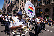 New York, NY - 25 June 2017. New York City Heritage of Pride March filled Fifth Avenue for hours with groups from the LGBT community and it's supporters. The New York Police Department marching band.