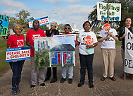 Members of the Concerned Citiznes of St. John and the Coalition Agianst Death Alley in front of the Denka Plant on the fourth day of a march through Cancer Alley.