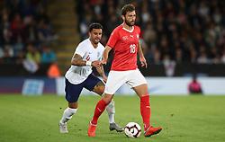 Switzerland's Admir Mehmedi (right) and England's Kyle Walker