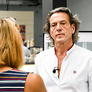 London, UK. 3rd September, 2018. Stephen Webster of Goldsmiths Craft & Design Council interview by reporter at the International Jewellery London 2018, Olympia London, UK.