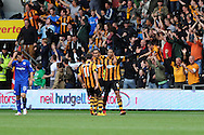 Hull's Curtis Davies ® celebrates after he scores the 1st goal. Barclays Premier league match, Hull city v Cardiff city at the KC Stadium in Hull on Sat 14th Sept 2013. pic by Andrew Orchard, Andrew Orchard sports photography,