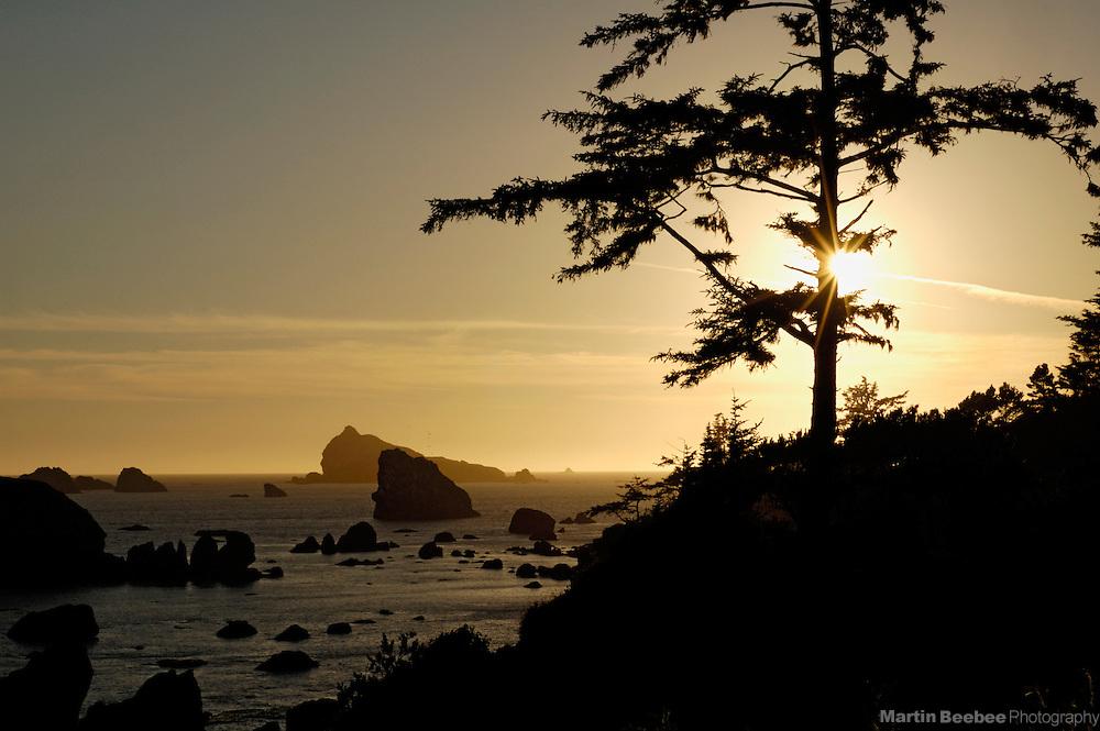 The sun sets along the rocky coast of Crescent City, California