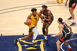 Jan 25, 2021; Morgantown, West Virginia, USA; West Virginia Mountaineers forward Derek Culver (1) drives down the lane against Texas Tech Red Raiders forward Tyreek Smith (10) during the second half at WVU Coliseum. Mandatory Credit: Ben Queen-USA TODAY Sports
