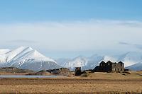 Old farmhouse in Mýrar, Southeast Iceland. Mount Hoffellsfjall in background left.