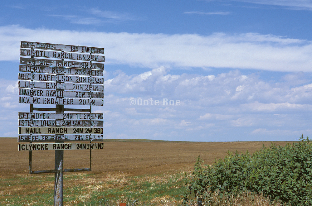 street sign giving directions to ranches