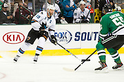 DALLAS, TX - OCTOBER 17:  Joe Thornton #19 of the San Jose Sharks controls the puck against the Dallas Stars on October 17, 2013 at the American Airlines Center in Dallas, Texas.  (Photo by Cooper Neill/Getty Images) *** Local Caption *** Joe Thornton