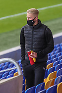 AFC Wimbledon defender Archie Proctor (25) stood in the stand during the EFL Sky Bet League 1 match between AFC Wimbledon and Bristol Rovers at Plough Lane, London, United Kingdom on 5 December 2020.