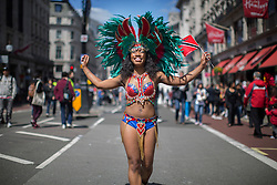 © licensed to London News Pictures. London, UK 12/05/2013. A dancer with carnival dress representing Trinidad and Tobago at The World on Regent Street event in London on Sunday, 12 May 2013. Many countries showcase the best of each country's culture, music and dance, art, food and fashion to Londoners on Regent Street. Photo credit: Tolga Akmen/LNP