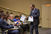Purchase, NY – 31 October 2014. Melvin Burrus collecting tally sheets from the judges to give to the scorekeeper. The Business Skills Olympics was founded by the African American Men of Westchester, is sponsored and facilitated by Morgan Stanley, and is open to high school teams in Westchester County.