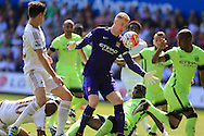 Joe Hart, the Manchester city goalkeeper saves from Federico Fernandez of Swansea city (l).  Barclays Premier league match, Swansea city v Manchester city at the Liberty Stadium in Swansea, South Wales on Sunday 15th May 2016.<br /> pic by Andrew Orchard, Andrew Orchard sports photography.